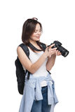 Young female tourist with backpack looking to her. Camera. Isolated on white stock image