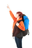 Young female tourist with backpack pointing up Stock Images
