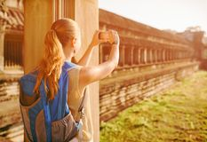 Female tourist taking picture in the Angkor Wat, Cambodia royalty free stock photo