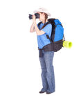 Young female tourist with camera. Young female tourist with backpack, carrimat and camera, full length, series royalty free stock image