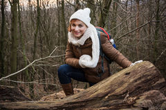 Young female tourist in a deciduous forest. Young female tourist posing in a deciduous forest. Hiking theme stock photography