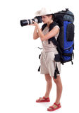 Young female tourist with digital camera Stock Photos