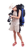Young female tourist with digital camera Royalty Free Stock Photos