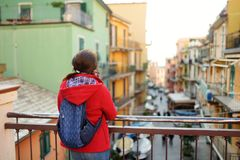 Young female tourist enjoying the view of Manarola, one of the five centuries-old villages of Cinque Terre, located on rugged. Northwest coast of Italian stock photo