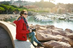 Young female tourist enjoying the view of small yachts and fishing boats in marina of Lerici town, located in the province of La. Spezia in Liguria, Italy stock photos