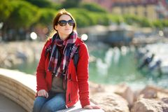 Young female tourist enjoying the view of small yachts and fishing boats in marina of Lerici town, located in the province of La. Spezia in Liguria, Italy royalty free stock images