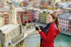 Young female tourist enjoying the view of Vernazza, one of the five centuries-old villages of Cinque Terre, located on rugged. Northwest coast of Italian stock photos