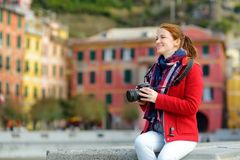 Young female tourist enjoying the view of Vernazza, one of the five centuries-old villages of Cinque Terre, located on rugged. Northwest coast of Italian stock photo