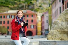 Young female tourist enjoying the view of Vernazza, one of the five centuries-old villages of Cinque Terre, located on rugged. Northwest coast of Italian royalty free stock photos