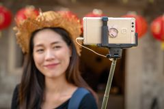 Young female tourist with selfie. Young female tourist with forgus on selfie stick stock photos