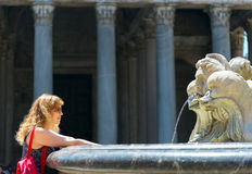 Young female tourist at the fountain in front of the Pantheon Royalty Free Stock Photography