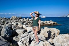 Young female tourist in hat Stock Images