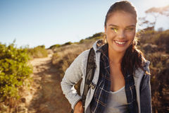 Young female tourist hiking in nature Royalty Free Stock Photo