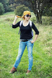 Young female tourist hiking in outdoors Royalty Free Stock Images
