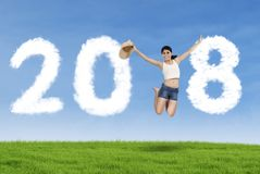 Young tourist jumping with numbers 2018 Royalty Free Stock Image