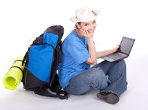 Young female tourist with laptop Royalty Free Stock Image