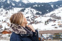 Female tourist in the swiss alps. Young female tourist looking to the snowy mountains in Grindelwald, swiss alps royalty free stock photo