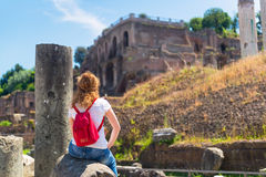 Young female tourist rests on the ruins of the Roman Forum in Ro Royalty Free Stock Photography