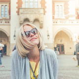 Young female tourist sitting near Cloth Hall in the old city center of Krakow royalty free stock image