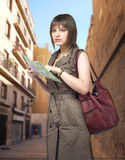 Young female tourist studying a map. In Spain royalty free stock photo