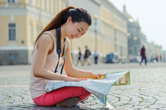 Young female tourist studying map Stock Photography