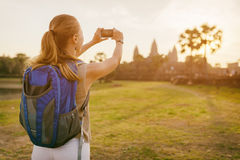 Young female tourist taking picture of Angkor Wat, Cambodia Royalty Free Stock Photo