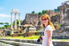 Young female tourist visiting the Roman Forum in Rome Stock Photo