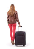 Young female with the travel bag, isolated Stock Photo