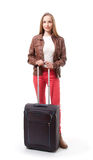 Young female with the travel bag, isolated royalty free stock image