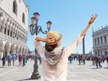 Young female traveler enjoying beautiful view on the Piazza San Marco, Venice royalty free stock images