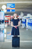 Young female traveler in international airport Royalty Free Stock Image