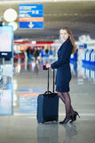 Young female traveler in international airport Royalty Free Stock Photography