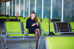 Young female traveler in international airport Royalty Free Stock Images