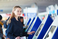 Young female traveler in international airport Stock Image