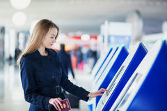 Young female traveler in international airport Royalty Free Stock Photos