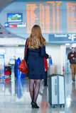 Young female traveler in international airport Stock Images