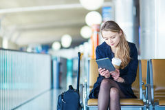 Young female traveler in international airport Stock Photos