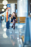 Young female traveler in international airport Royalty Free Stock Photo