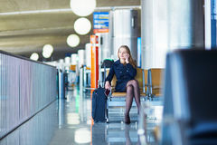 Young female traveler in international airport Stock Photography