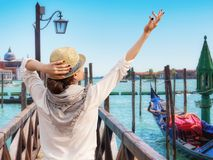 Young female traveler on pier enjoying beautiful view, Venice royalty free stock photos