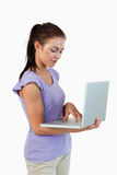 Young female typing on her laptop Royalty Free Stock Photos