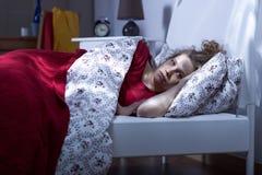 Young female unable to sleep Stock Photo