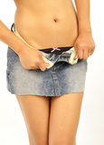 Young female unbuttoning her mini skirt Stock Photography