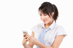Young female using cell phone Stock Image
