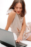 Young female using a laptop Stock Image