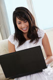 Young female using laptop Stock Photography