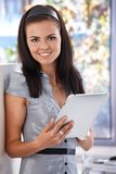 Young female using tablet PC Royalty Free Stock Images