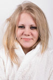 Tired young cute woman in bathrobe Royalty Free Stock Image
