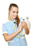 Young female veterinarian doctor carrying a rabbit Stock Photo