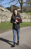 Young female vicar walking in her parish Royalty Free Stock Photos